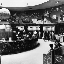 An overhead mural inside the terminal portrayed the history of flight. The large round room is also home to a bust of Fiorello LaGuardia.