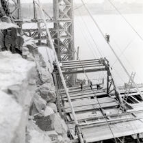 Site conditions were different on opposite sides of the Hudson River, which is reflected in the designs of the anchorages. On the New Jersey side, the cables are anchored to the solid rock of the Palisades. The top of the Palisades ridge were chiseled out, and caverns were blasted and cut into the side of the cliff for the anchorages. The anchorage on the Manhattan side is a man-made behemoth constructed with reinforced concrete.