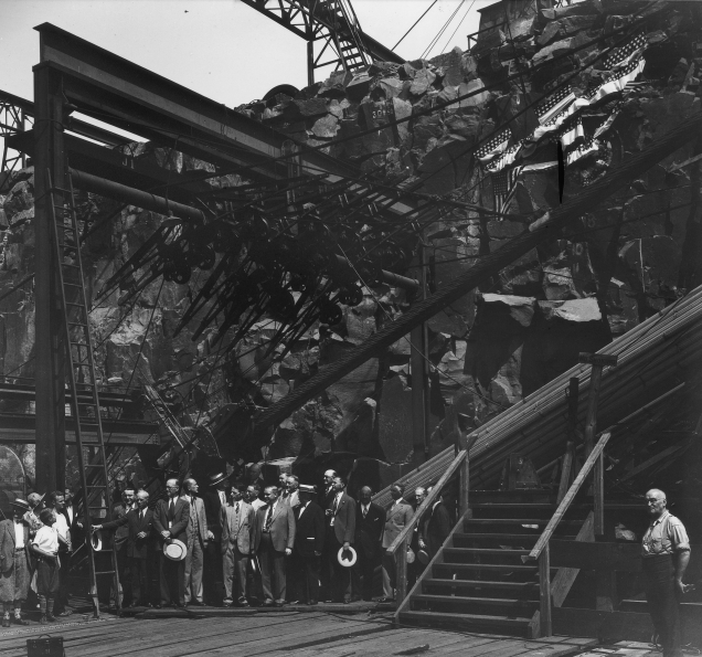 Turning Othmar H. Ammann's engineering vision into a functioning facility began with a groundbreaking ceremony in Fort Lee, New Jersey on September 21, 1927. Over the course of more than four years, men and machines poured hundreds of thousands of yards of concrete for the anchorages and roadways, strung tons of galvanized steel wire for the suspension and suspender cables, and fastened together tons of structural steel for the bridge's two towers and road deck. Foundations for the towers and the anchorages were excavated and constructed first and then built at the same time. The project's budget was set at $60 million for land, acquisition, demolition and construction. It opened to the public on October 25, 1931 --eight months ahead of schedule and $1 million under budget. When it opened, it was the longest main-span suspension bridge in the world. It remains the most traversed bridge in the world.