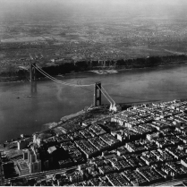 The bridge's two towers stand 604 feet above water. The bridge spurred widespread economic development, which resulted in explosive community growth.
