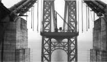 Roadway assembly of the side span viewed from within the Manhattan anchorage. The bridge's roadway connects to Fort Lee, New Jersey. To keep the structure in balance, the roadway had to be assembled symmetrically beginning at both towers. It moved outward in both directions simultaneously.