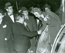 Mayor LaGuardia greets a flight attendant.