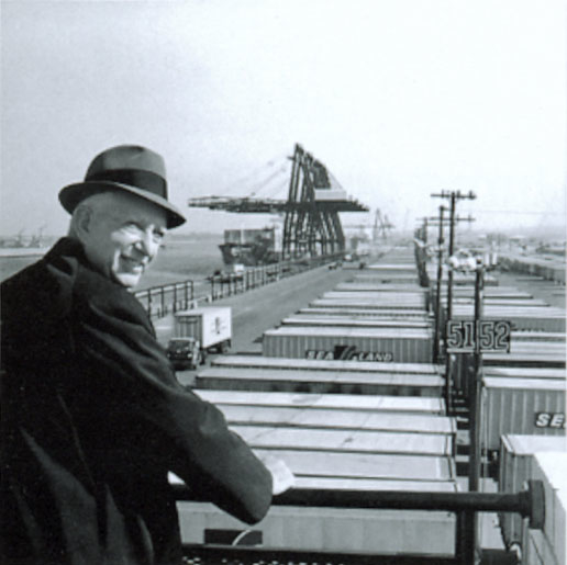 Malcolm_McLean_at_railing,_Port_Newark,_1957_(7312751706)