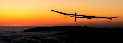 solar-impulse-2-plane-flying-at-night-photo-wallpaper-luggage-online-1024x360