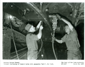 Workers tightening the tunnel bolts. Most of the skilled sandhogs on the job received an average of $10 for a day's work, which consisted of two three-hour shifts with three hours' rest in between.