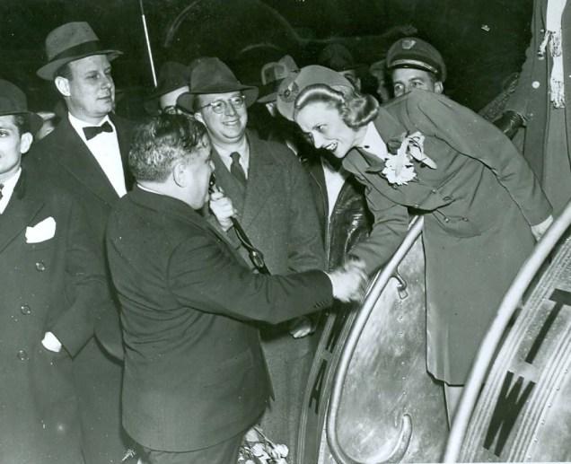 MAYOR LAGUARDIA GREETS FLIGHT ATTENDANTS AT LAGUARDIA AIRPORT ON FIRST FLIGHT DECEMBER 2, 1939