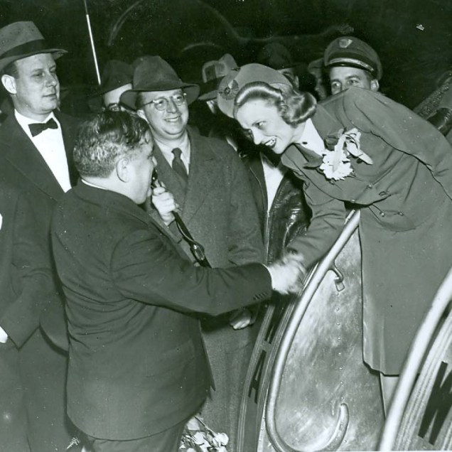 MAYOR LAGUARDIA GREETS FLIGHT ATTENDANTS AT LAGUARDIA AIRPORT ON FIRST FLIGHT DECEMBER 2, 1939
