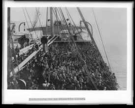 Group of immigrants on the deck of the S.S. Patricia