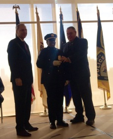 Sergeant Lawanda Irving pictured at center with Chief Security Officer Tom Belfiore to the left and Police Superintendent Mike Fedorko to the right