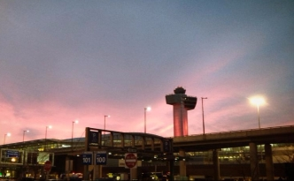JFK control tower lit in pink