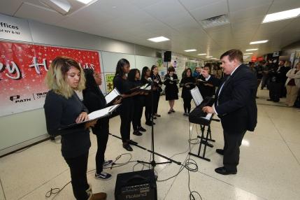 Jersey City Arts Vocal Program sang Christmas carols for PATH Poster Contest ceremony