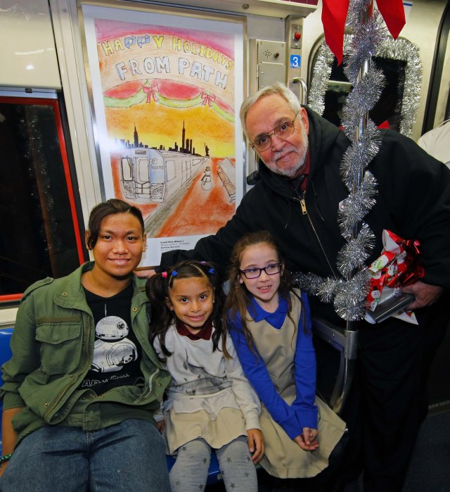 PATH Poster Contest winners from left to right are Renfrew, Skyla-Jean, Cora with PATH General Manager Mike Marino