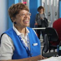 Carolyn Brown, retired social worker after 50 years of work, has been guiding JFK passengers with an easy laugh and warm smile for the last nine years.
