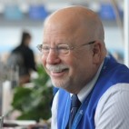 Larry Margolin, retired advertising executive and 8-year volunteer, describes his role as equal parts concierge, social worker and boy scout.