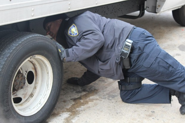 PAPD CVI Walter Franco inspecting a commercial vehicle